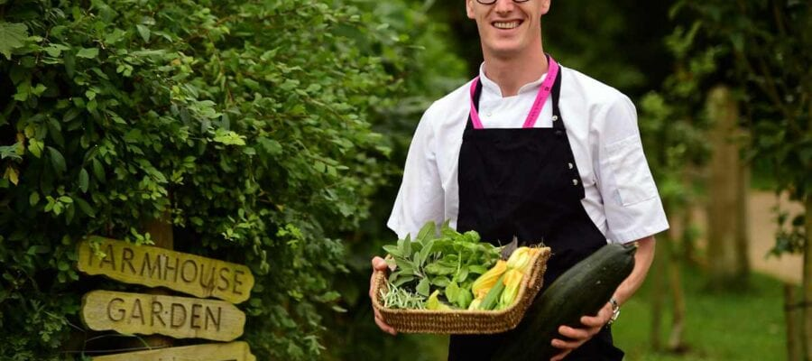 Chef gathering herbs and vegetables from the Kitchen Garden at Stowe. National Trust ImagesJohn Millar